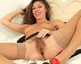 Cute hairy mom playing with her pussy