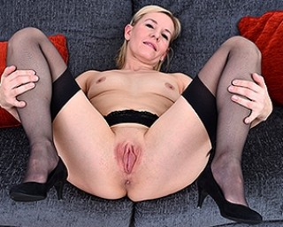 Naughty blonde housewife playing with her pussy