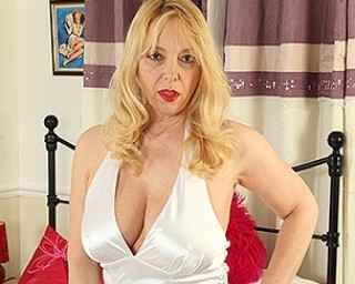 Big breasted MILF playing with her pussy