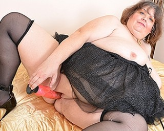 Naughty big breasted BBW playing with herself
