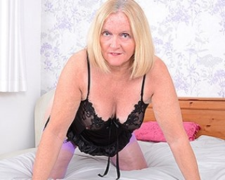 Mature Antoinette loves getting very naughty with her comb