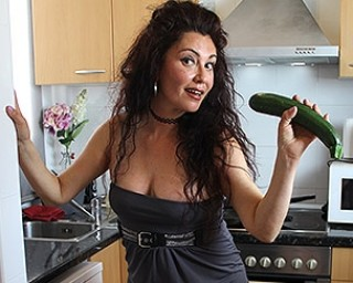 Spanish housewife Zazel Paradise playing with a cucumber