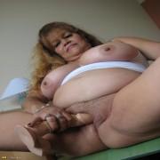 Big mature slut showing off her big tits