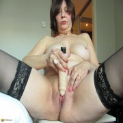 Horny housewife stuffing her pussy with a dildo