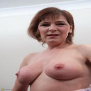 This naughty housewife loves playing with her pussy