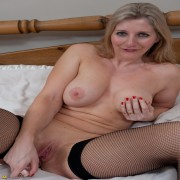 Hot blonde mama showing off her luscious body