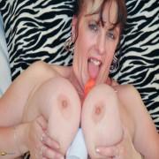 Huge breasted mature slut getting wet