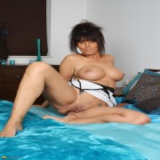 Horny MILF getting herself wet and wild