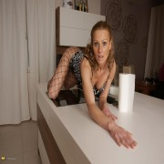 Horny MILF playing on the kitchen counter