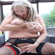 Naughty UK mature lady touching herself