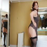 Naughty European housewife taking a bath