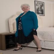 Naughty Big breasted British granny getting frisky
