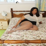 Big breasted British black mature bbw is getting naughty