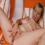Naughty housewife playing in her bed