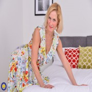 Naughty British housewife playing with her pussy in bed