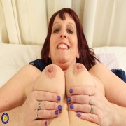 Horny housewife playing with her wet pussy in bed