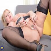 Naughty housewife Lorna Blu showing off her great rack