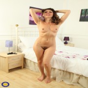 Hot French mom Chloe is playing with her hairy pussy