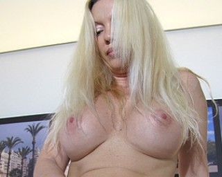 Blonde MILF playing all alone