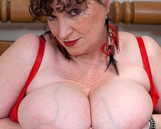Big Breasted mature KIM loves to get naughty