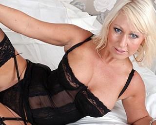 Hot blonde MILF masturbating on her bed